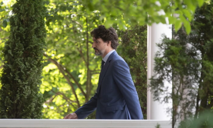 Prime Minister Justin Trudeau returns to Rideau Cottage following a news conference in Ottawa on June 22, 2020. (THE CANADIAN PRESS/Adrian Wyld)