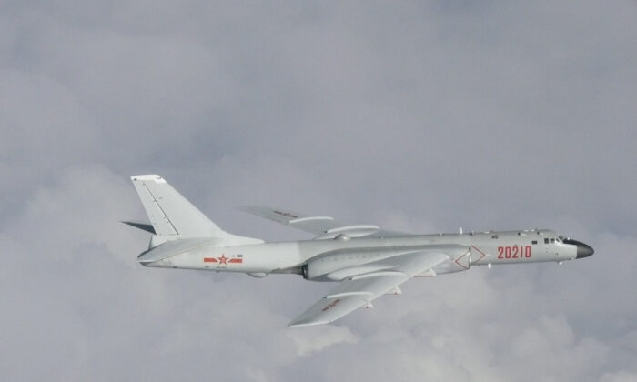 A Chinese H-6 bomber flies over the East China Sea in a picture released on July 23, 2019. (Joint Staff Office of the Defense Ministry of Japan/Handout via Reuters)