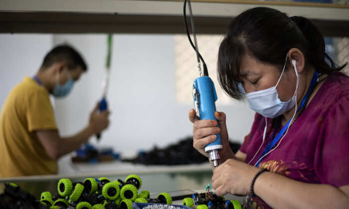 Workers assembling toys at the Mendiss toy factory in Shantou, Guangdong Province, on May 20, 2020. Cancelled shipments, returned goods, and a dearth of new orders have left Chinese exporters in crisis as the coronavirus hits its trading partners worldwide. (Noel Celis/AFP via Getty Images)