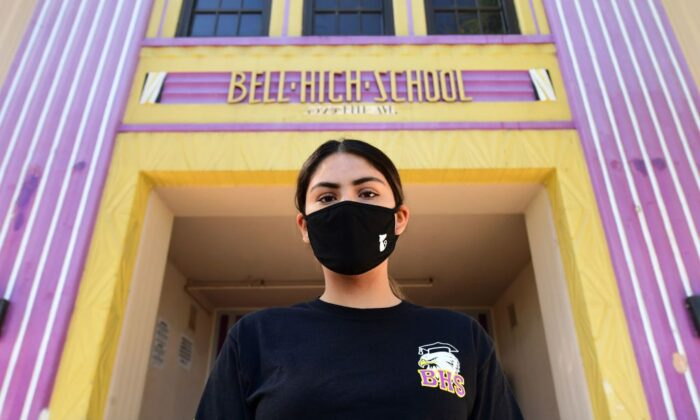 Bell High School senior Kenia Molina in front of her school, closed due to the COVID-19 pandemic, in Bell, Calif., on April 15, 2020. (Frederic J. Brown/AFP via Getty Images)