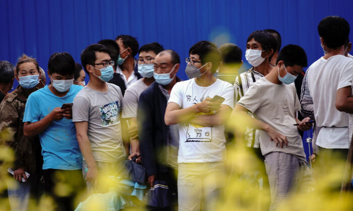 Residents who visited or live near Xinfadi Market line up for a nucleic acid test in Beijing on June 19, 2020. (Lintao Zhang/Getty Images)