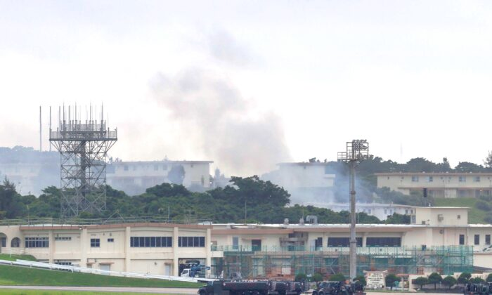 Smoke rises from at the 18th Wing Hazardous Materials Pharmacy building at Kadena Air Base during a fire on Okinawa island, Japan,on June 22, 2020. (Kyodo News via AP)