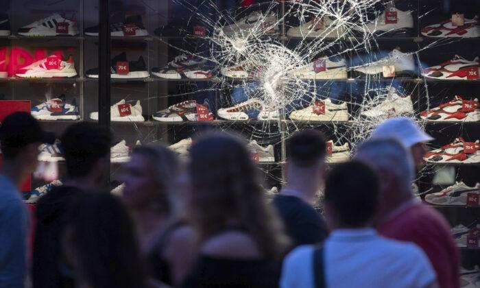 Attack on a window of a retail store in Stuttgart, Germany, on June 21, 2020. (Marijan Murat/dpa via AP)