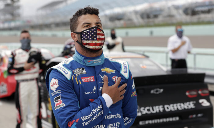 Bubba Wallace stands for the national anthem before a NASCAR Cup Series auto race in Homestead, Fla., on June 14, 2020. (Wilfredo Lee/AP Photo)