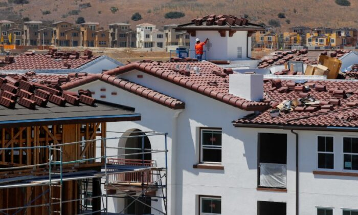 Construction work on a large scale housing project of over 600 homes in Oceanside, Calif., on June 25, 2018. (Mike Blake/Reuters)