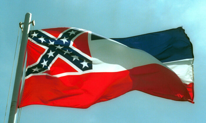 A file photo showing Mississippi state flags flies on a flag pole. (Bill Colgin/Getty Images)