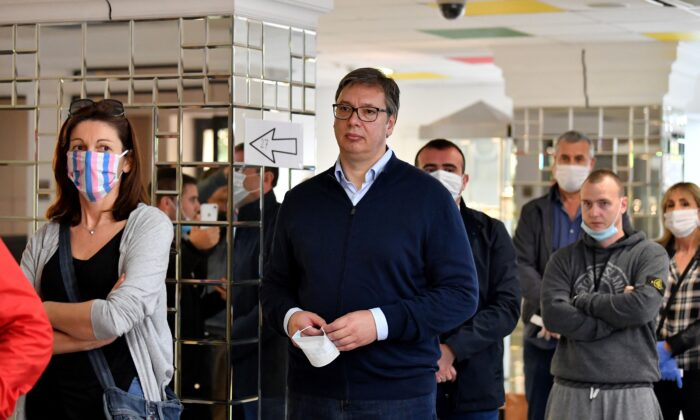 Serbian President Aleksandar Vucic waits in line to cast his ballot at a polling station in Belgrade on June 21, 2020. (Andrej Isakovic/AFP via Getty Images)