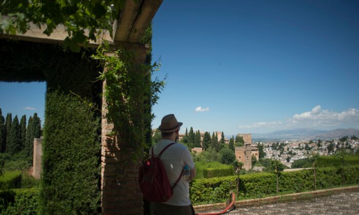 A tourist visits the Alhambra in Granada on June 17, 2020. (Jorge Guerrero/AFP via Getty Images)