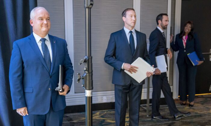 (L–R) Conservative Party leadership candidates Erin O'Toole, Peter MacKay, Derek Sloan, and Leslyn Lewis practise social distancing while waiting for the start of the French leadership debate in Toronto on June 17, 2020. (The Canadian Press/Frank Gunn)