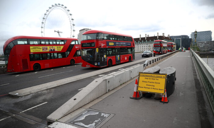 A sign reminding people about social distancing is seen on Westminster bridge, as the outbreak of the CCP virus continues, in London, Britain, June 19, 2020. (Hannah Mckay/Reuters)