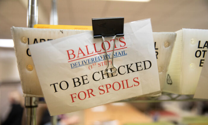 Mailed-in ballots sit in U.S. Postal Service bins at the office of the Stanislaus County Clerk in Modesto, Calif., on Nov. 6, 2018. (Alex Edelman/Getty Images)