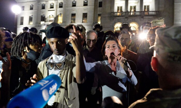 Gov. Gina Raimondo (C) addresses protesters during Black Lives Matter protests in Providence, R.I., on June 5, 2020. (Joseph Prezioso/AFP via Getty Images)