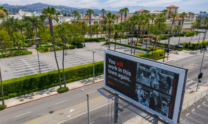 A billboard offers hope of work resuming after COVID-19-related shutdowns in Los Angeles, Calif., on June 12, 2020. (David McNew/Getty Images)