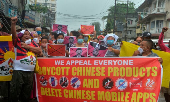 Indian activists along with Tibetans living in exile shout anti Chinese slogans during an anti-China demonstration in Siliguri on June 20, 2020. (Diptendu Dutta/AFP via Getty Images)