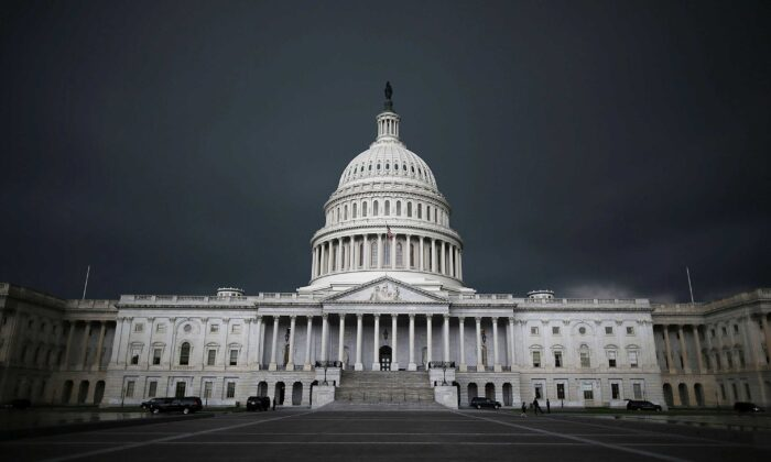 Storm clouds fill the sky over the U.S. Capitol Building in Washington on June 13, 2013. (Mark Wilson/Getty Images)