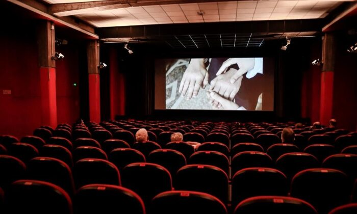 People sit in a cinema in Milan, Italy, on June 15, 2020. A new poll suggests two-thirds of Canadians don't want to relax the physical distancing rules imposed to curb the spread of COVID-19. (The Canadian Press/AP, LaPresse, Claudio Furlan)