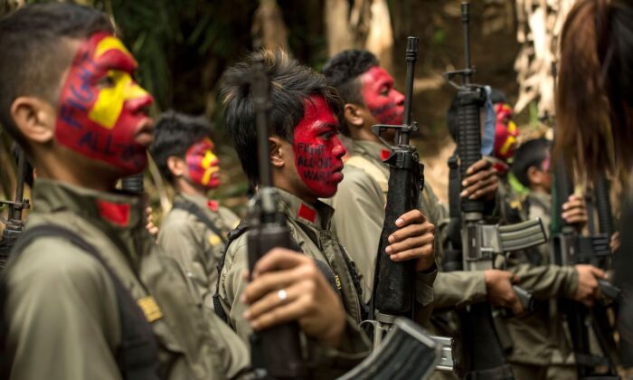 Guerrillas of the New People's Army in formation in the Sierra Madre mountain range, located east of Manila, the Philippines, on July 30, 2017. (Noel Celis/AFP via Getty Images)
