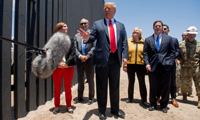 President Donald Trump speaks to the media as he participates in a ceremony commemorating the 200th mile of border wall at the international border with Mexico in San Luis, Ariz., on June 23, 2020. (Saul Loeb/AFP via Getty Images)