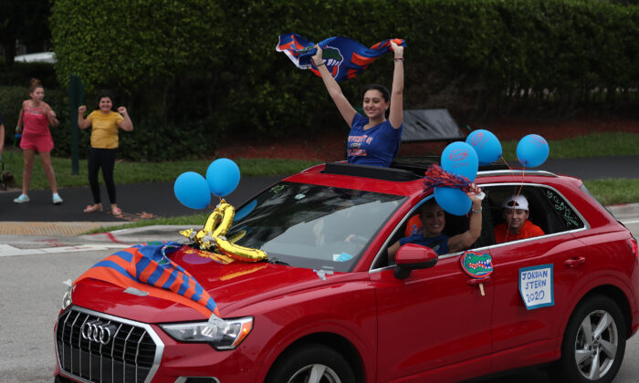Jordan Stern participates in a parade of vehicles celebrating the area's graduating high school seniors on May 14, 2020, in Aventura, Fla. (Joe Raedle/Getty Images)