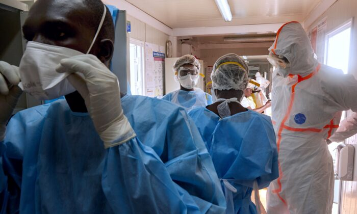 Medical staff of International Medical Corps (IMC) put on Personal Protective Equipment (PPE) at the isolation ward of Ministry of Health Infectious Disease Unit in Juba, South Sudan, on April 24, 2020. (Alex McBride/AFP via Getty Images)