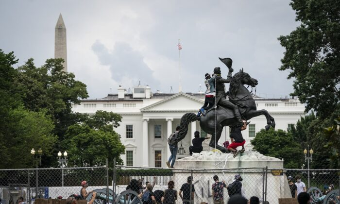 Protesters attempt to pull down the statue of Andrew Jackson in Lafayette Square near the White House on June 22, 2020. (Drew Angerer/Getty Images)