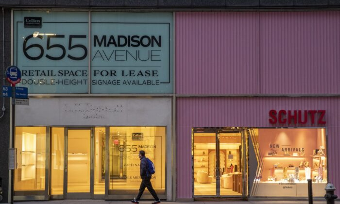 A pedestrian walks past a storefront for rent on Madison Avenue, in New York on March 19, 2020. (Mary Altaffer/AP Photo)