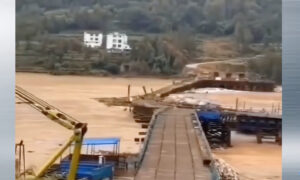 Unfinished Multi-Million Dollar Bridge Swept Away by Flood in China