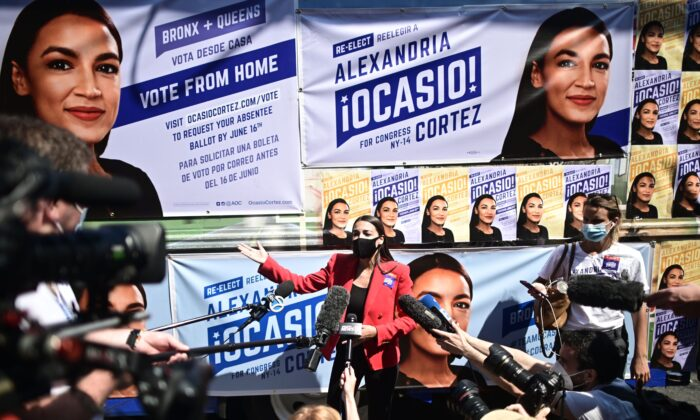 U.S. Rep. Alexandria Ocasio-Cortez (D-N.Y.) speaks to the press near a polling station during the New York primaries Election Day in New York City on June 23, 2020. (Johannes Eisele/AFP via Getty Images)