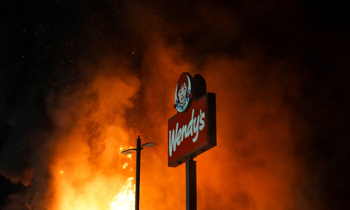 A Wendy's burns following a rally in the wake of the police shooting death of Rayshard Brooks, in Atlanta, Ga., June 13, 2020. (Elijah Nouvelage/Reuters)