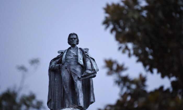 A 100-foot monument to former U.S. vice president and slavery advocate John C. Calhoun towers over a downtown square in Charleston, S.C., on June 23, 2020. (Meg Kinnard/AP Photo)