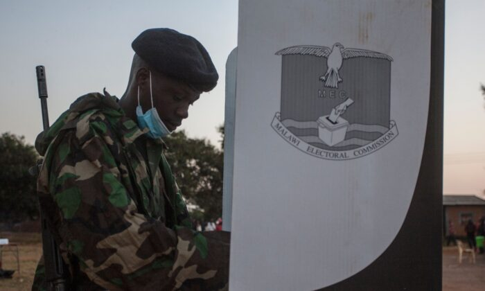 A soldier votes at a polling booth during the presidential elections at the Malembo polling station in Lilongwe on June 23, 2020. (Amos Gumulira/AFP via Getty Images)