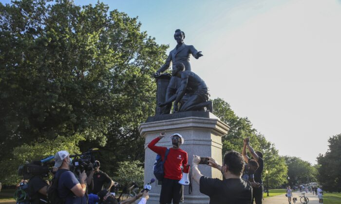 Protesters gather at Lincoln Park to demand the Emancipation Memorial be taken down in Washington on June 23, 2020. (Tasos Katopodis/Getty Images)