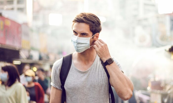 Masks must be worn properly and disposed of effectively if they are to have a good effect. (Ander5/Shutterstock)