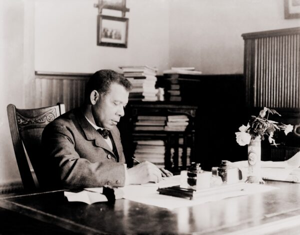 Booker T. Washington at desk