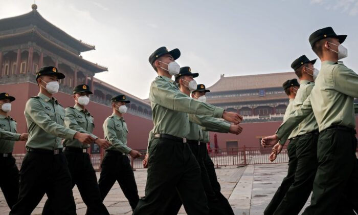 People's Liberation Army (PLA) soldiers march next to the entrance to the Forbidden City during the opening ceremony of the Chinese People's Political Consultative Conference (CPPCC) in Beijing on May 21, 2020. (Nicolas Asfouri/AFP via Getty Images)