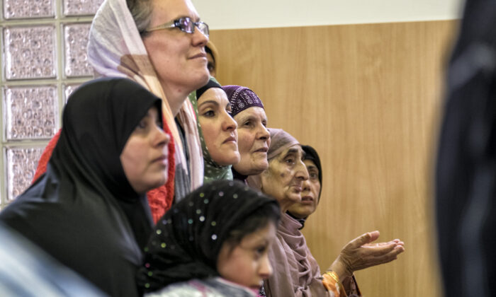 Women listen to a local Imam during National Mosque open day at the Werribee Islamic Centre in the suburb of  Hoppers Crossing in Melbourne, Australia on October 25, 2014. (Luis Ascui/Getty Images)