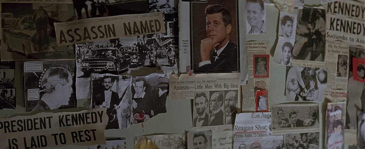 """pinned up newspaper articles in """"In the Line of Fire"""""""