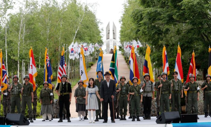 Actors wearing military uniforms with flags of countries which participated in the Korean War perform during a ceremony to mark the 70th anniversary of the outbreak of the Korean War in Cheorwon, near the border with North Korea, South Korea, on June 25, 2020. (Ahn Young-joon/AP Photo)