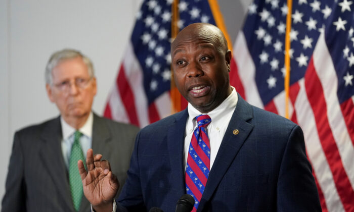 Senate Majority Leader Mitch McConnell (R-Ky.) listens as Sen. Tim Scott (R-S.C.) speaks to reporters after the Senate Republicans weekly policy lunch on Capitol Hill in Washington, on June 23, 2020. (Kevin Lamarque/Reuters)