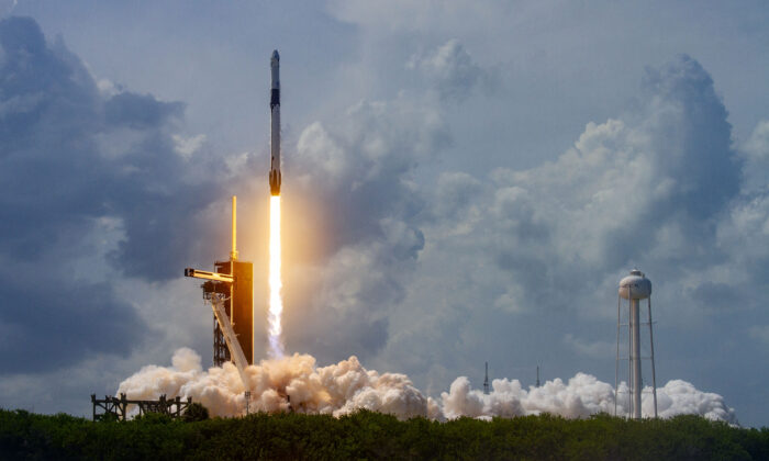 In this SpaceX handout image, a Falcon 9 rocket carrying the company's Crew Dragon spacecraft launches on the Demo-2 mission to the International Space Station with NASA astronauts Robert Behnken and Douglas Hurley onboard at Launch Complex 39A May 30, 2020, at the Kennedy Space Center, Cape Canaveral, Florida. The Demo-2 mission is the first launch of a manned SpaceX Crew Dragon spacecraft. It was the first launch of an American crew from U.S. soil since the conclusion of the Space Shuttle program in 2011. (Photo by SpaceX via Getty Images)