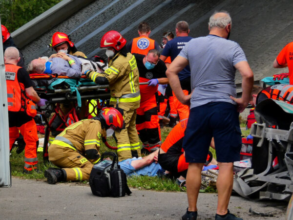 First responders treat the injured at the scene of a public bus crash,