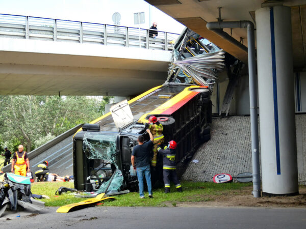 Fire crews climb onto a public bus at the scene its crash