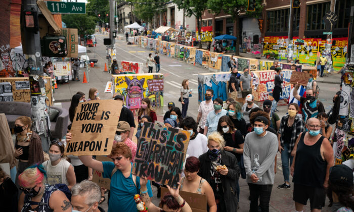 Protesters march through the area known as the Capitol Hill Organized Protest (CHOP) in Seattle, Washington, on June 24, 2020. (David Ryder/Getty Images)