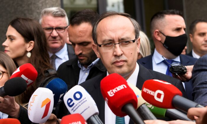 Newly elected Prime Minister of Kosovo Avdullah Hoti speaks to the media in Pristina after a parliament session on June 3, 2020. (Armend Nimani/AFP via Getty Images)