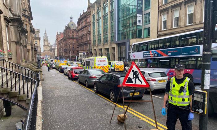 In this picture obtained from social media, emergency responders are seen near a scene of reported stabbings, in Glasgow, Scotland, Britain, on June 26, 2020. (@JATV_Scotland/via Reuters)