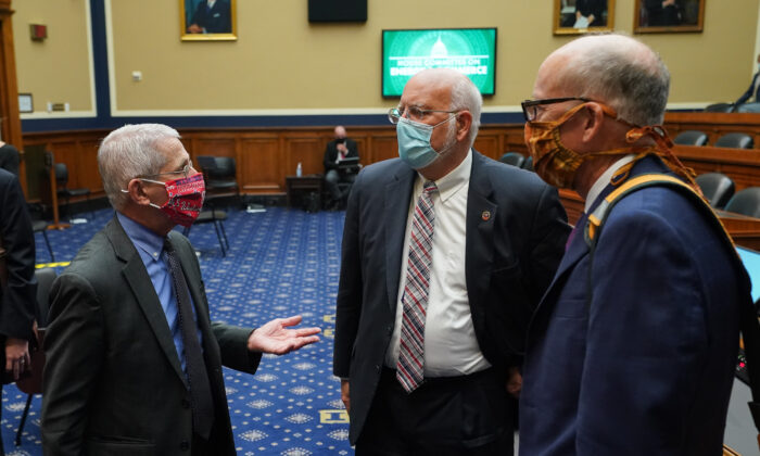 (L-R) Dr. Anthony Fauci, director of the National Institute for Allergy and Infectious Diseases, Dr. Robert Redfield, director of the Centers for Disease Control and Prevention, and Ranking Member Greg Walden (R-OR) talk after after testifying during a House Energy and Commerce Committee hearing on the Trump Administration's Response to the COVID-19 Pandemic, on Capitol Hill in Washington, DC, on June 23, 2020. (Photo by Kevin Dietsch/various sources/AFP via Getty Images)