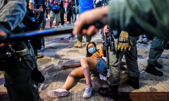 People are detained as pro-democracy protesters gather in the Causeway Bay district of Hong Kong on June 12, 2020. (Anthony Wallace/AFP via Getty Images)