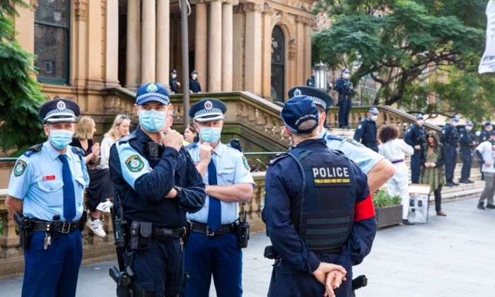 A police presence is seen on the steps of the Sydney Town Hall during a protest in Sydney, Australia on June 13, 2020. (Jenny Evans/Getty Images)