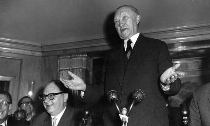 German Chancellor Dr. Konrad Adenauer speaks at a press conference at the Dorchester Hotel, London, on Jan. 1, 1959. (Keystone/Getty Images)