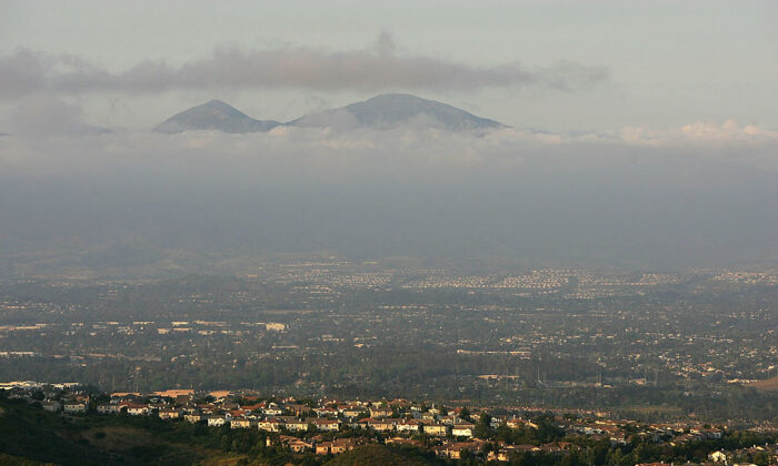 Urban sprawl that has filled most of Orange County spreads out in front of a ridge in Laguna Coast Wilderness Park south of Irvine, Calif., on April 23, 2008. (David McNew/Getty Images)